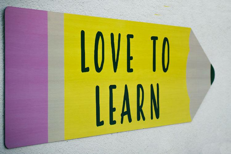 Schild Love to learn